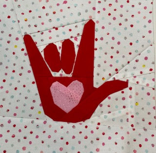 I love you hand sign quilt block pattern, BLM fundraiser pattern, we stand together, quilters against racism